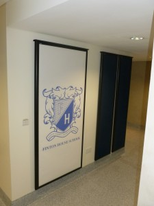 The school's logo printed to acoustic panels