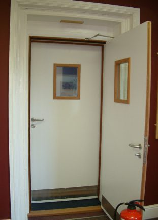 Dual leaf acoustic doors with vision panels